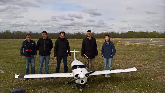 ONERA and SZTAKI members with the K50 aircraft. SZTAKI 2 camera system can be seen under the wings and the japanise RICOH stero sensor under the body.